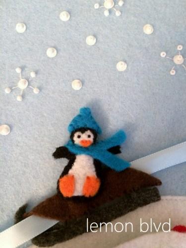 Penguin Sled - sledding winter quiet book page - lemon blvd