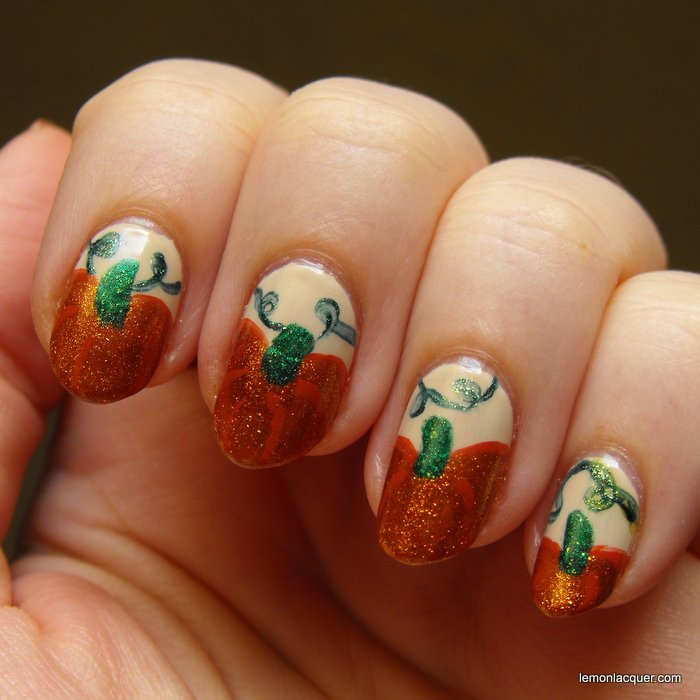 pumpkin nail art in shimmery orange