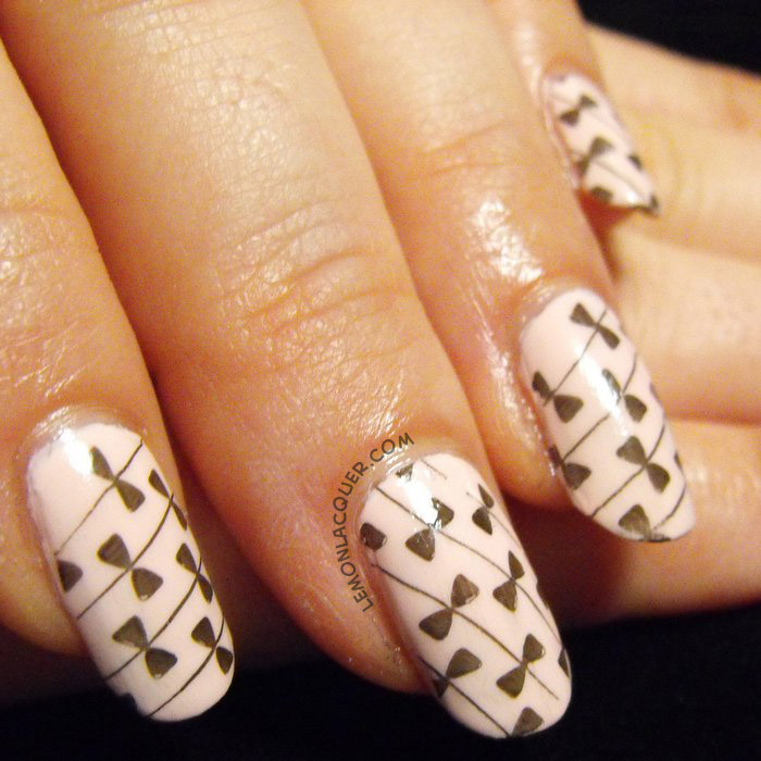 Nail stamping with black over pale pink