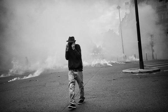 Tear gas and lonely man. French Labor Law Protests. Paris.