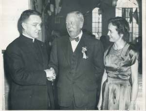 Bruce and Dorothy Abts Mohler at a formal event with an unnamed priest in 1949, the same year of their marriage. Though they had no children, they left a formidable financial and archival legacy. Photograph from the Dorothy Abts Mohler Papers, ACUA.