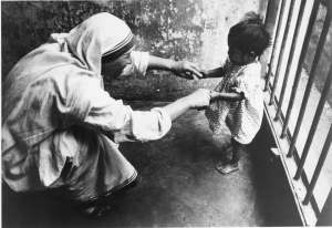 Mother Teresa playing with an abandoned child, Kolkata, 1960. American Catholic History Research Center and University Archives.