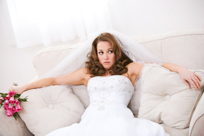 Bride: Annoyed Bride Sits On Couch with Bouquet