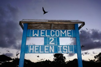 The welcoming sign right on the beach of Helen Reef