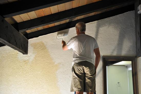 Bob painting the wall
