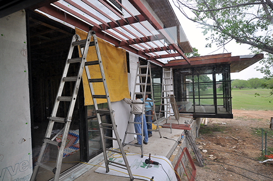 welders putting up protection before work begins