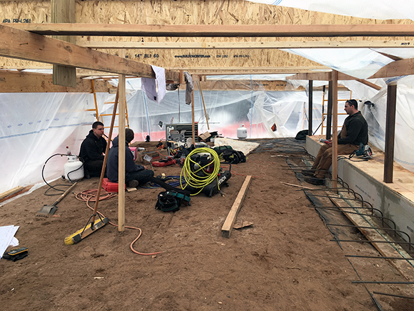 Workers sitting in the tented area
