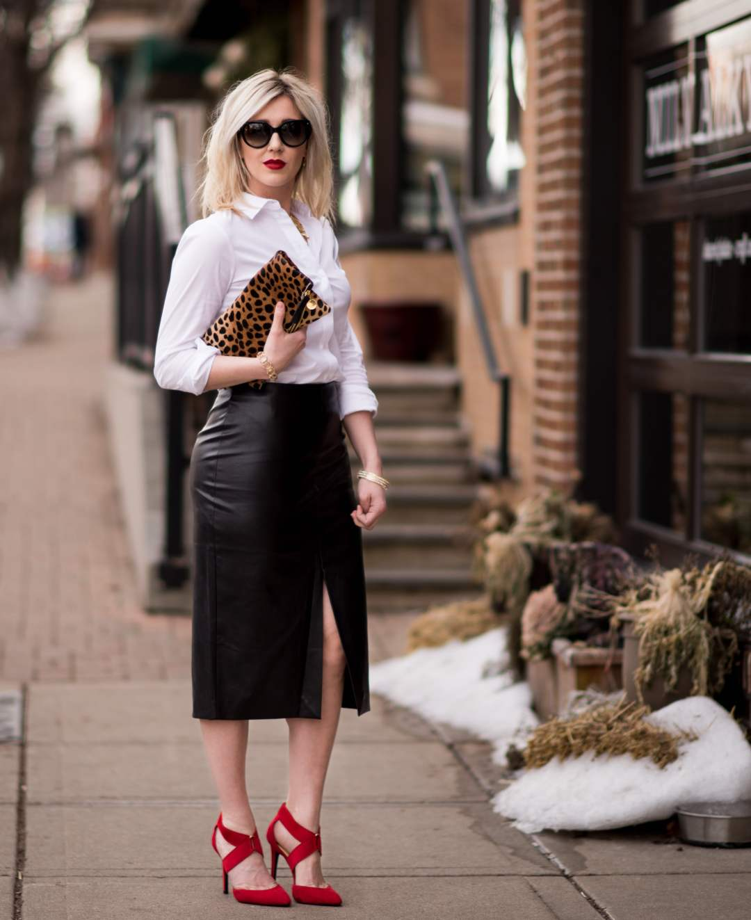 leather skirt & a red lip