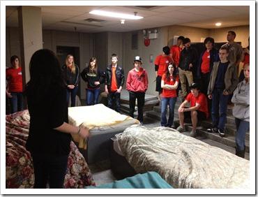 DeeAnn Mercier giving Rosthern Junior College a tour of the men's dorm