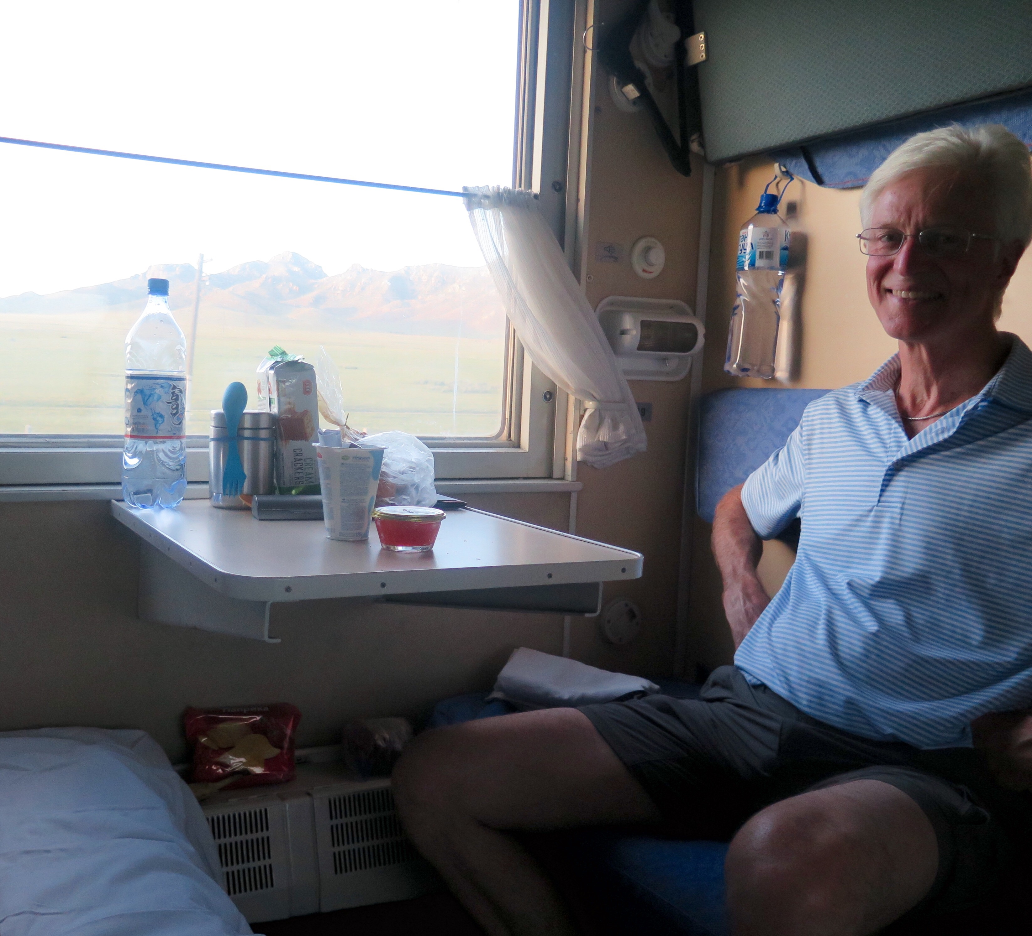 Steve in our compartment. (If you can tell, I've already made up my bed in this picture, although Steve hasn't made his.)