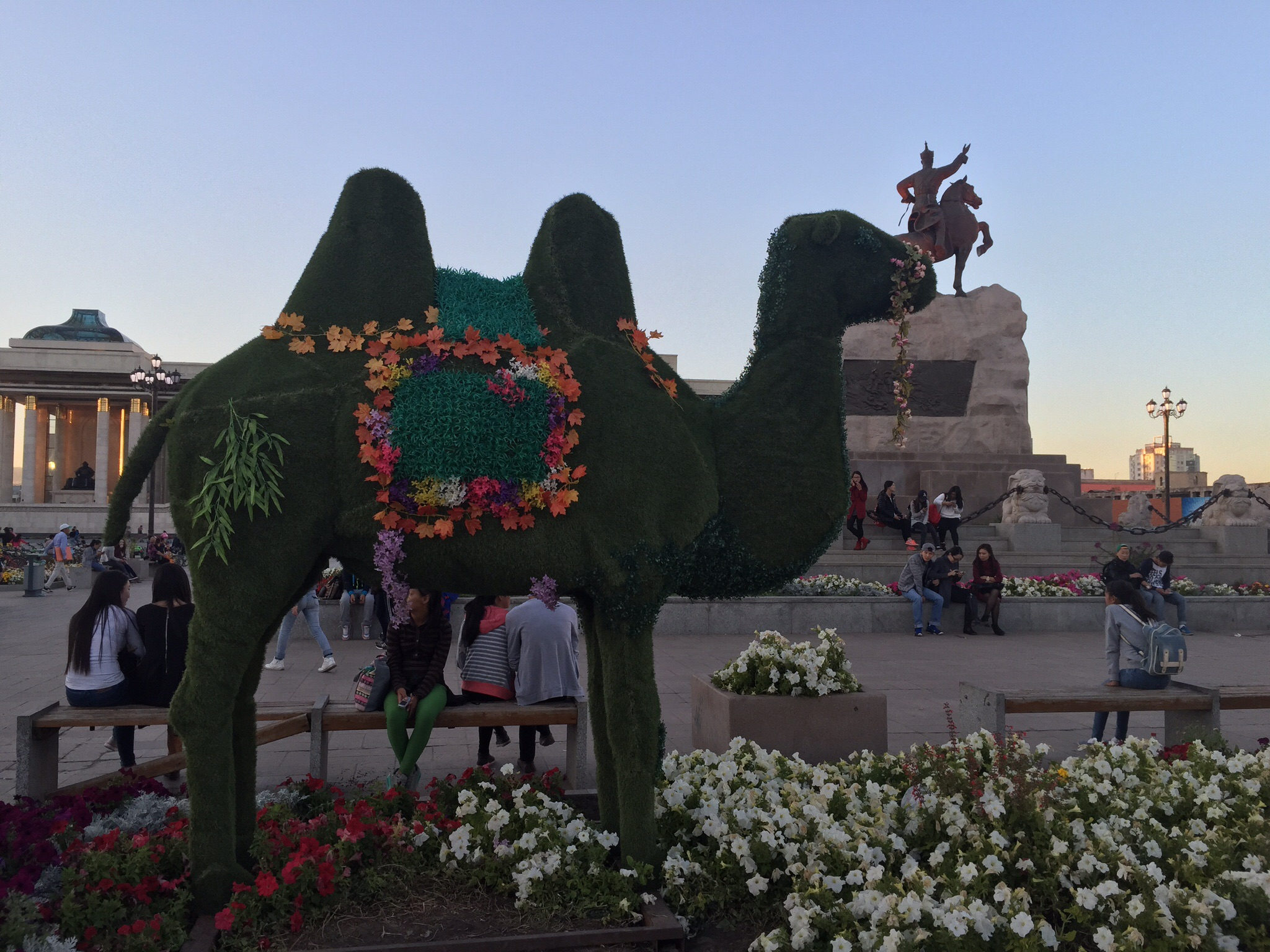 The camel was covered in astroturf and plastic flowers.