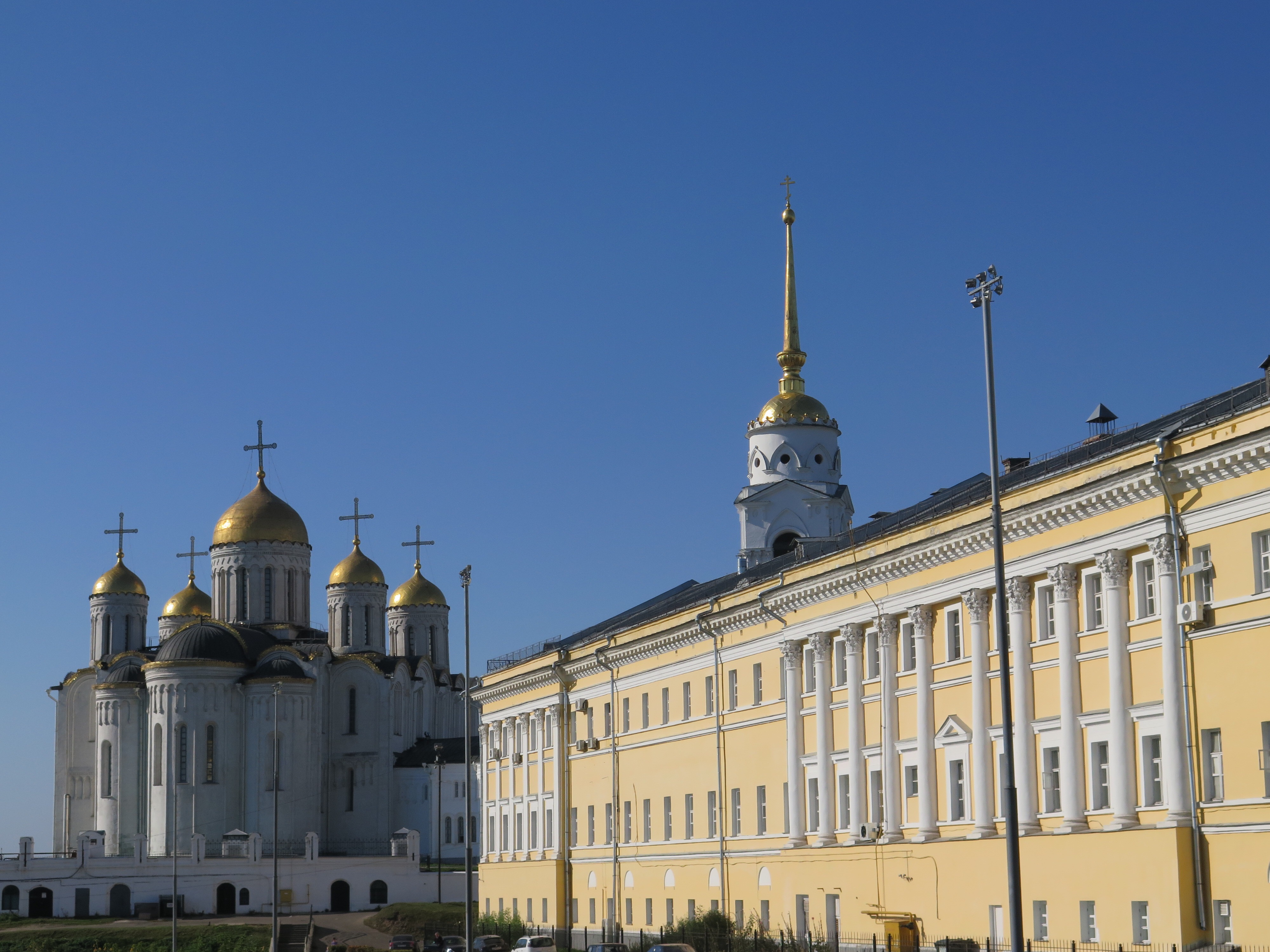 Assumption Cathedral is in the background. I am not sure what the yellow building houses.