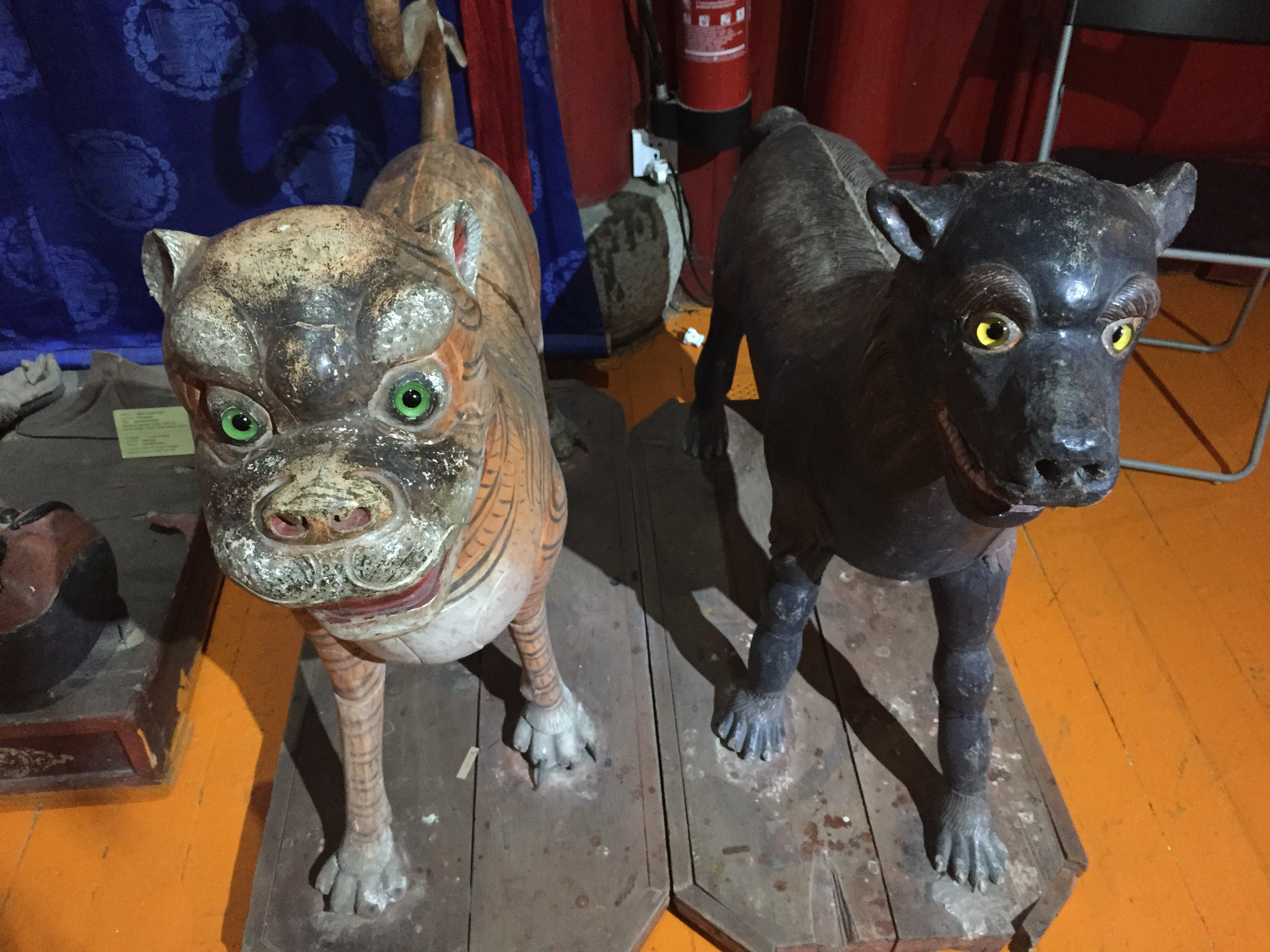 These guard animals where on either side of a door, with no sign. They seemed a bit haphazardly placed to me. I'm not sure what they were originally for.