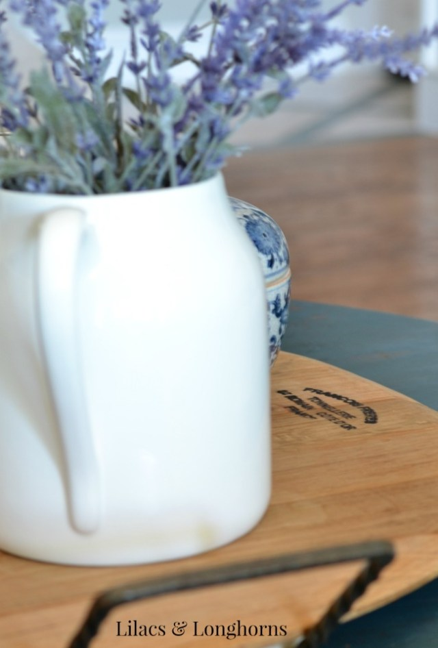 white pitcher on wine barrel cheese tray
