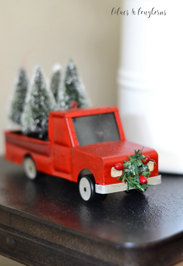 red truck with Christmas wreath and Christmas trees / Lilacs and Longhorns