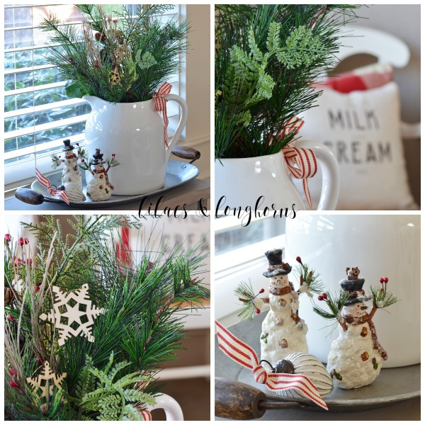 Christmas vignette white pitcher greenery snowmen