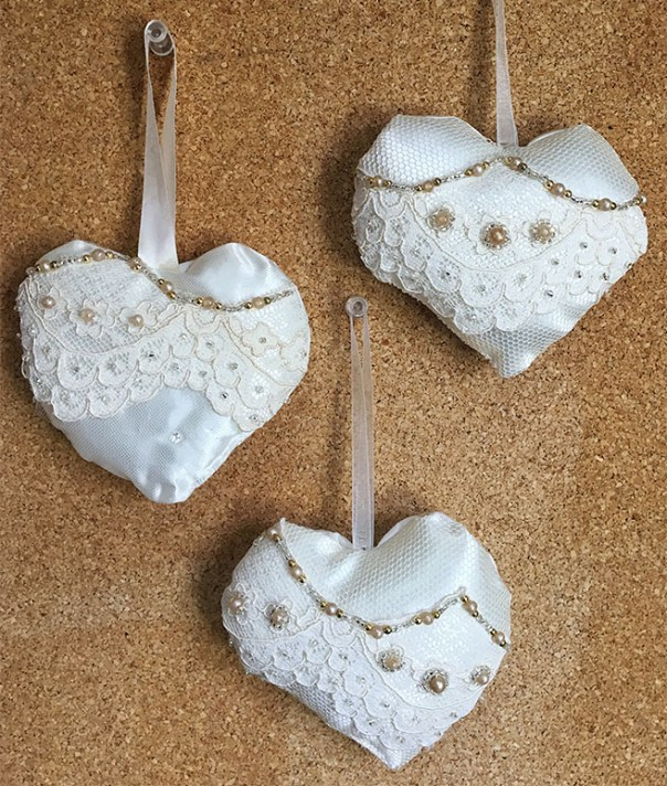 Three softie hanging hearts made from upcycled fabric