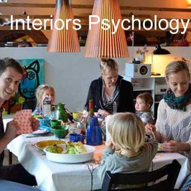 Family enjoying cozy meal together = interiors psychology