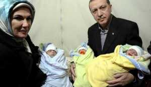 Turkish Prime Minister Tayyip Erdogan and his wife Emine Erdogan pose with Syrian refugee triplet babies near Akcakale border crossing on the Turkish-Syrian border, southern Sanl