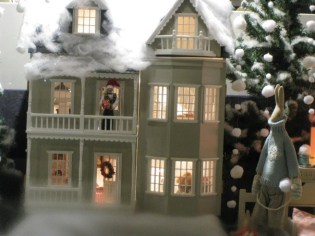 Christmas doll house in the showcase
