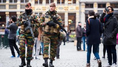 Belgian Army soldiers patrol in the picturesque Grand Place in the center of Brussels on Friday, Nov. 20, 2015.  Salah Abdeslam, a French national who lived in Molenbeek, Belgium, is currently the subject of an international manhunt after the Paris attacks. Security has been stepped up in parts of Belgium as a precaution. (ANSA/AP Photo/Geert Vanden Wijngaert)