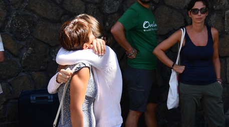 Displaced people from their homes in the area of he highway-bridge-collapse disaster in Genoa, Italy, 15 August 2018. People living in the buildings in the area have been evacuated following the collapse of a section of the Morandi bridge because there is a risk the other parts of the bridge could fall. The death toll for Tuesday's highway-bridge-collapse disaster has risen to 39, according to reports on 15 August, and the Italian Government will proclaim national mourning for the Genoa tragedy.   ANSA/LUCA ZENNARO