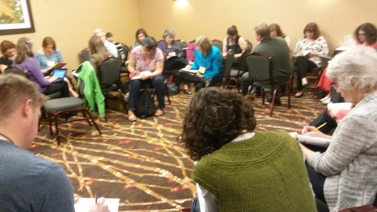 This picture was taken at NESCBWI, after some dramatic activities that inspired writing. It may not look that chaotic here, but this is a writing break between crazier moments. Note that the chairs aren't in their neat and tidy rows.