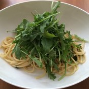 top with arugula