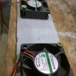 Fans attached to plastic baffle