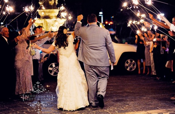 Sparklers make for a sweet exit. Photo: Weddings by Scott and Dana