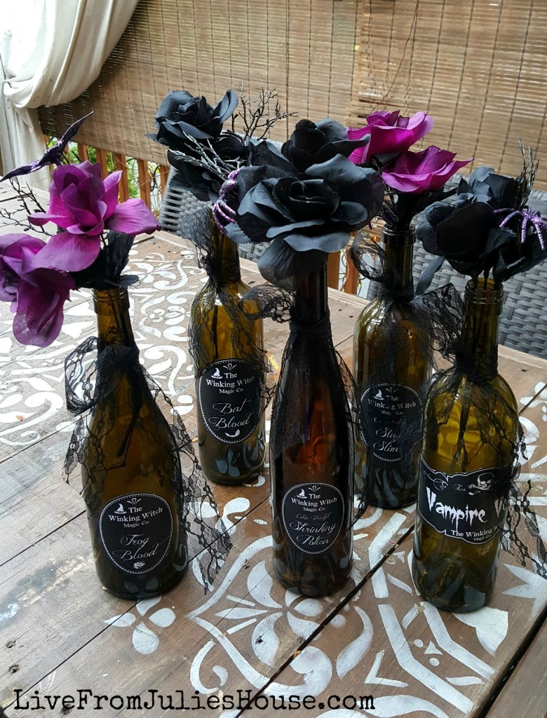 Halloween Decor on the Cheap: Pretty Poison Vases - I made these fast, easy and cheap Halloween centerpieces using old wine bottles, dollar store flowers and DIY labels made with PicMonkey.