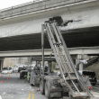 Garbage truck damaged I-90 Front Street overpass in March 2015. Photo: WSDOT