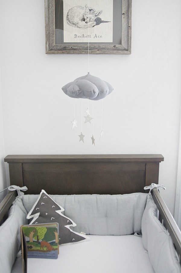 Gray nursery - gender neutral nursery that is a shared room.