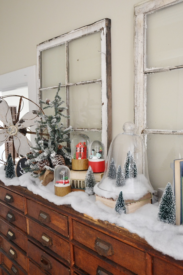 Rustic Christmas card catalog decor - holiday snow globes, christmas trees, a faux rustic Christmas village. Simple & easy Christmas decor.