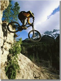 man jumping on his mountain bike