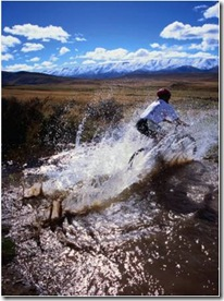 mountain biking across a creek