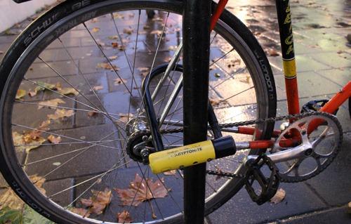 Bike lock going through the rear wheel of a bike