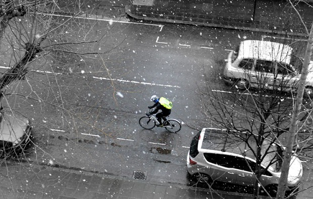 A cyclist is cycling in the snow