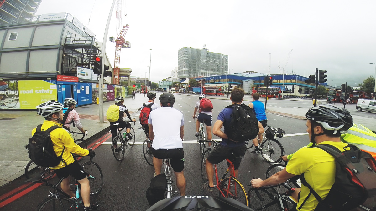 Cyclists waiting at a red light