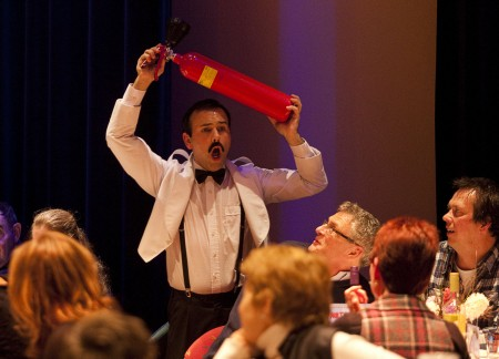 Faulty Towers Dining Experience Manuel with a fire extinguisher