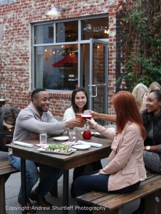 Friends enjoy dinner together at the Oakhart Social restaurant located on West Main Street in Charlottesville, Va. Photo/Andrew Shurtleff