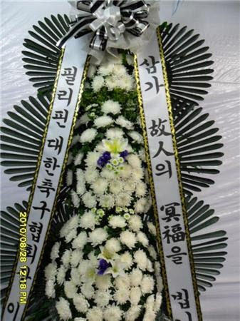 White Chrysanthemums are the dominant flower in any Asian funeral.