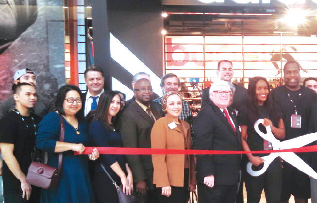 Cerritos Councilman Jim Edwards, third from right, at the ribbon cutting with Adidas management and Cerritos Chamber participants. Photo by Tammye McDuff.