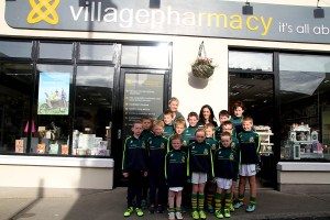 Village Pharmacy, Carlingford sponsores of Cooley Kickhams Juveniles from Nursery to U12's. With the children is Fidelma Brady(mentor) Maria McGrath (Village Pharmacy) and Joan McCarragher(Mentor)