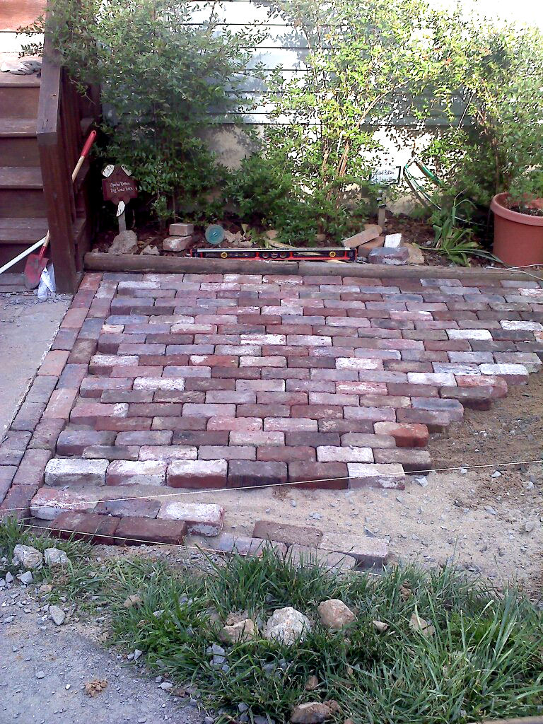 I Used A Level To Make Sure The Patio Was Matching My Slope (laid Out By My  Diagonal Twine, Described Here). Using A Rubber Mallet, I Tapped Each Brick  Into ...