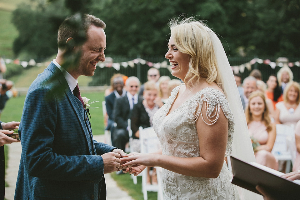 Terri wore an Anna Campbell inspired gown made by her mum, for her outdoor Summer wedding in the Cotswolds. Photography by McKinley Rodgers, film by Story Catchers Wedding Films.