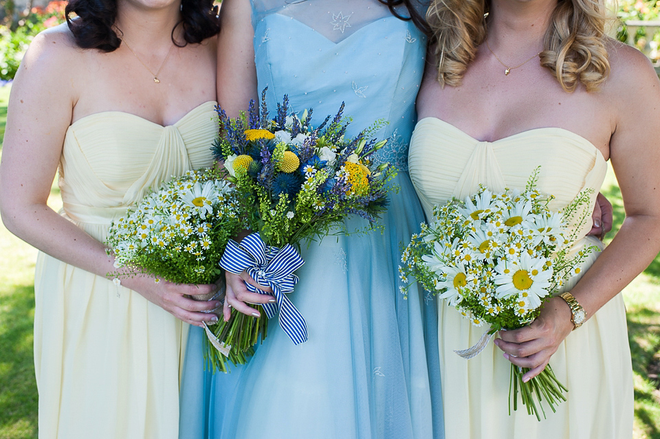 A pretty pale blue wedding dress for a nautical inspired Summer wedding by the sea. Photography by Alexandria Hall.