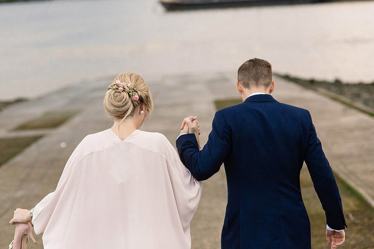 Celine wore a short, chic, pale pink wedding dress for her non-traditional wedding at the Greenwich Yacht Club in London. Captured by Paul Joseph Photography.
