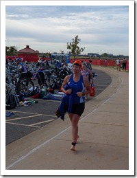 Trotting over to transition area for the next round... 56 miles on her bike.