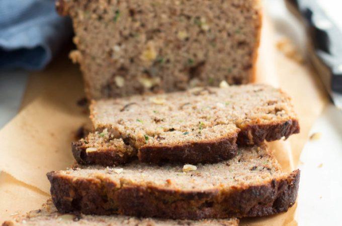 Sliced Low Carb Zucchini Bread on a cutting board.